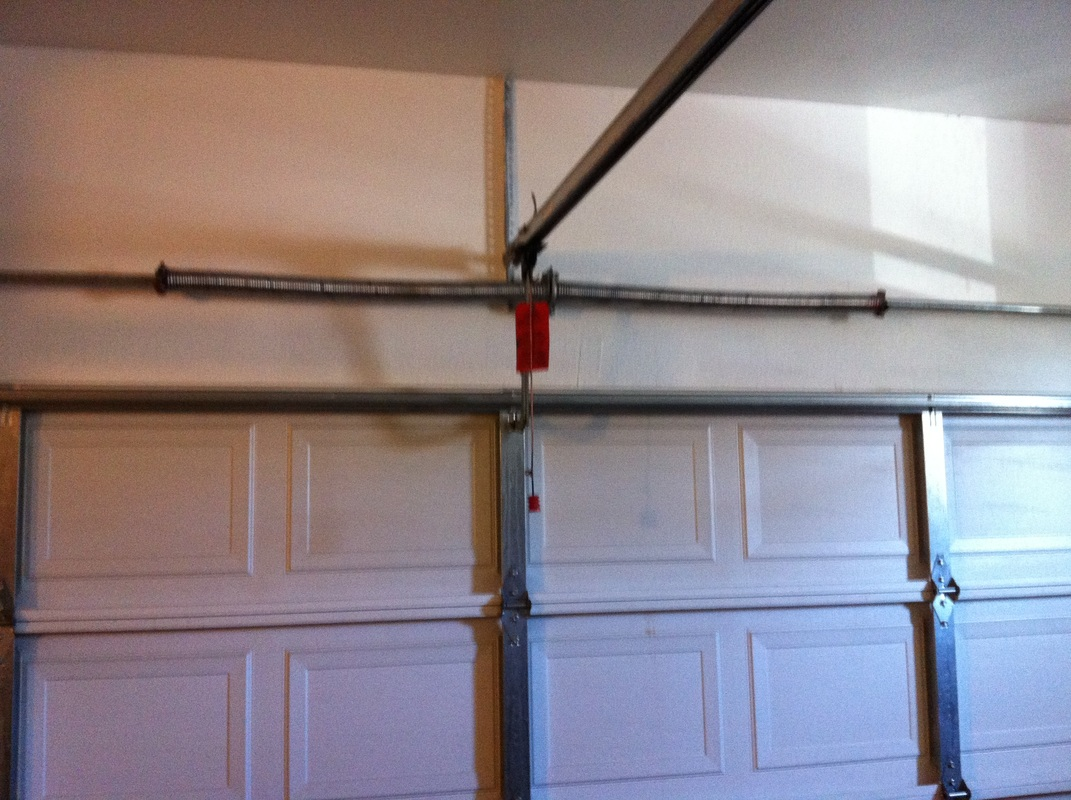 Garage door torsion spring repaired. Broken garage door torsion spring door won t go up   Garage Door